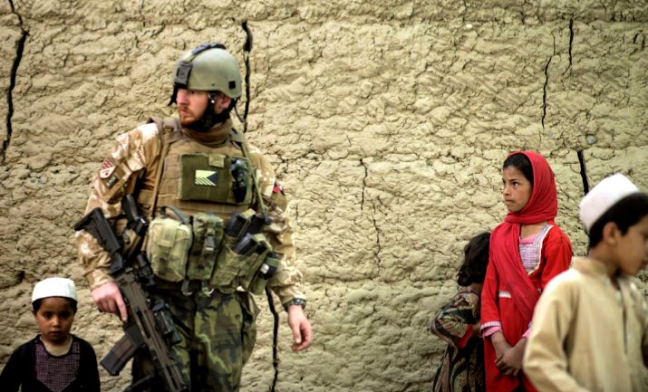 Strengthen NATO: A Czech solider is joined by Afghan children while on patrol at a village near Bagram Airfield. the US base in Parwan province