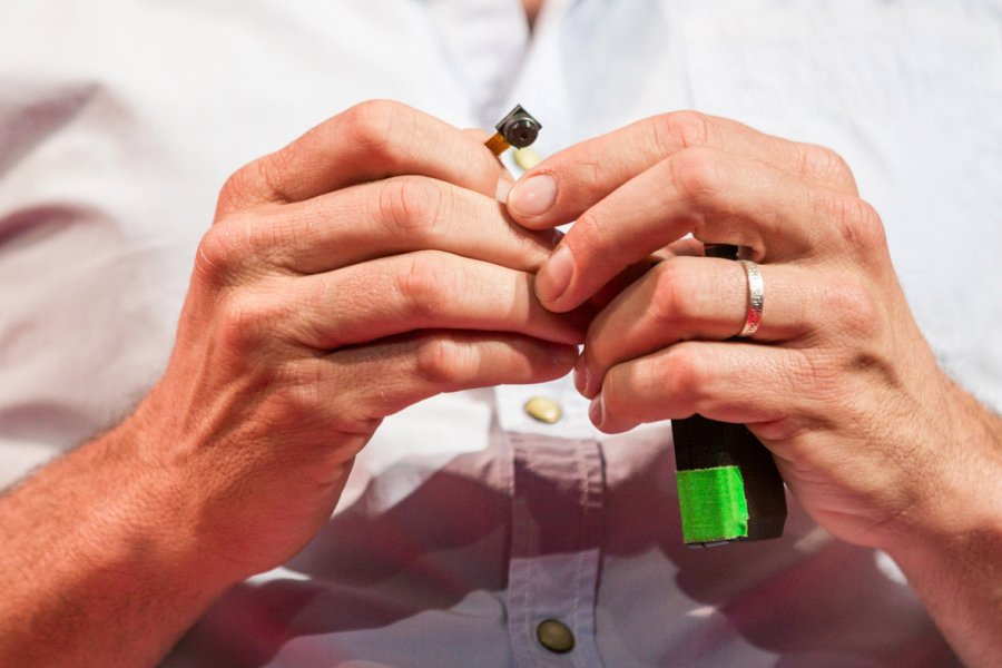 Close-up of miniature hidden cameras held by Oren Yakobovich at TEDGlobal 2014. Photo James Duncan Davidson TED