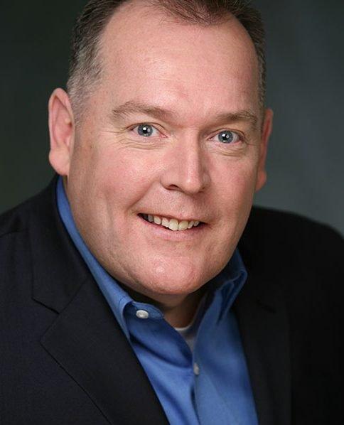 John Sweeney in suit